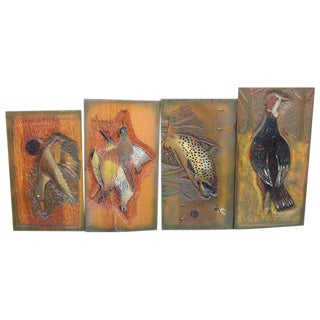 Collection of Four Game and Fish Carvings