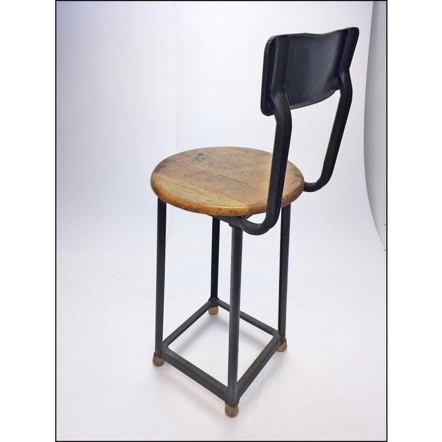 Vintage industrial green metal wood drafting stool