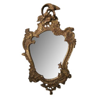 A Curvaceous Italian Rococo Style Cartouch-Shaped Carved Giltwood Mirror