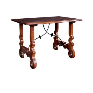 A Rustic Spanish Baroque Style Walnut Trestle Table with Iron Stretcher