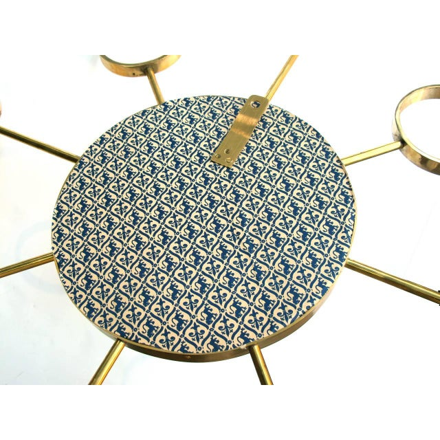 Image of An Iconic Pair of 1960's Stylized Solid Brass Sunburst Mirrors