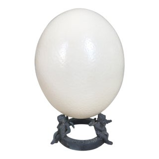 Ostrich Egg On Cherub Stand