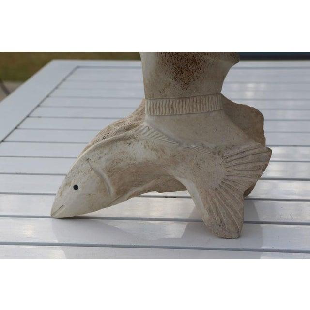 Image of Fossilized Whalebone Vertebrae Sculpture with Face by Wilbur Kuzuguk
