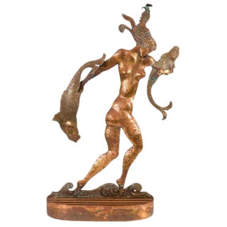 ART DECO SCULPTURE OF A NUDE WOMAN CARRYING FISH IN THE STYLE OF HAGENAUER