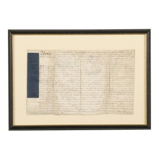 An ancient indenture from England c.1800 enclosed in the original frame.