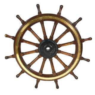 A very large-scale mahogany, iron and brass ship's wheel, English, circa 1900