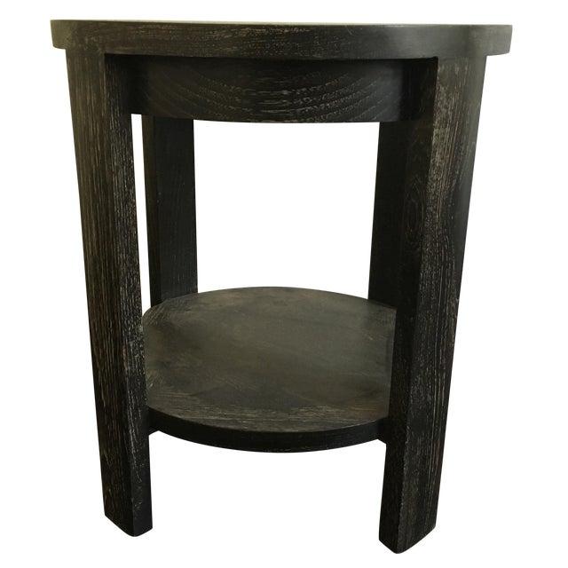 round black ebonized solid wood side table