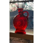 Image of Red Glass Bottle