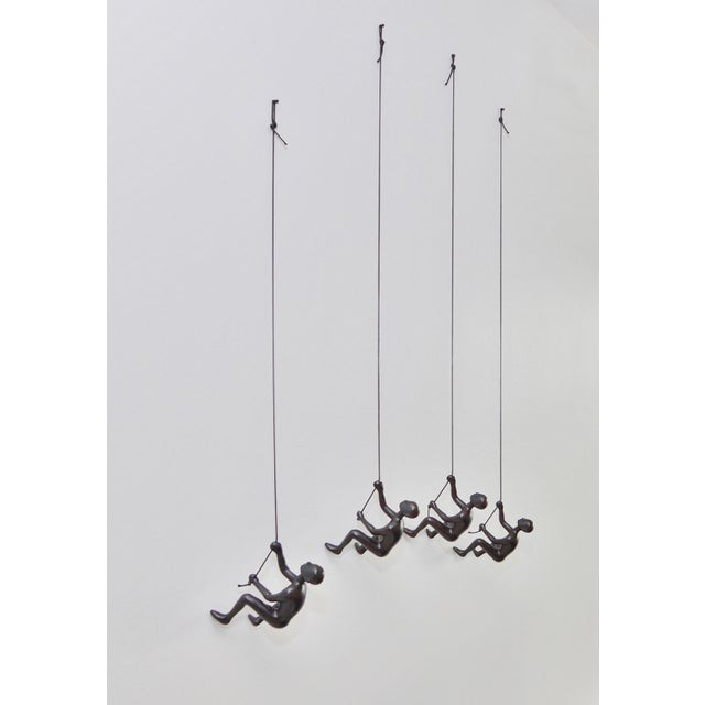 Image of Black Climbing Man Wall Art - Set of 4