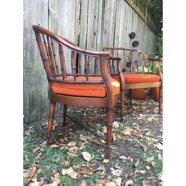 Image of Bamboo Chairs & Orange Cushions - Pair