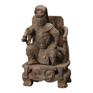 A 19th century Chinese carving of an emperor seated on a throne having beautiful detail
