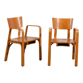 An Unusual Pair of Bent Plywood Arm Chairs by Thonet