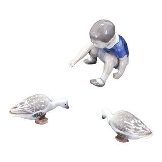 "Set of Three Royal Copenhagen Porcelain Figurines ""Boy Feeding Geese"""