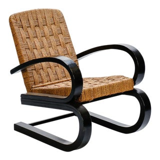Italian Bent Wood and Woven Rush Armchair In The Manner of Audoux Minet