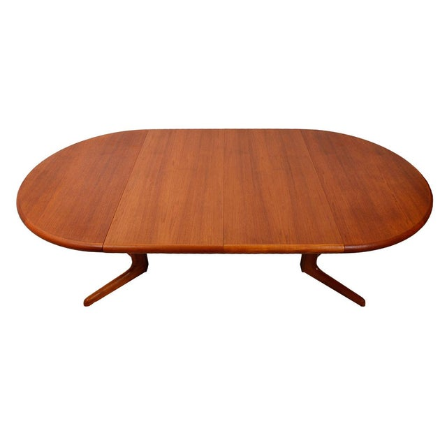 Image of Danish Teak Round-To-Oval Expanding Dining Table