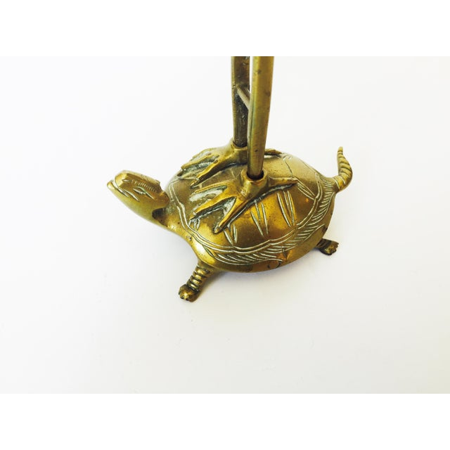 Image of Vintage Brass Crane on a Tortoise