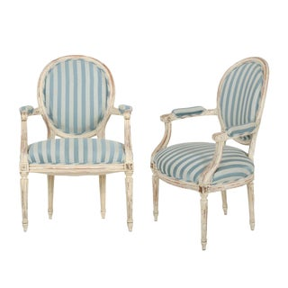 French Louis XVI Style Distressed White Painted Arm Chairs, 20th Century - a Pair