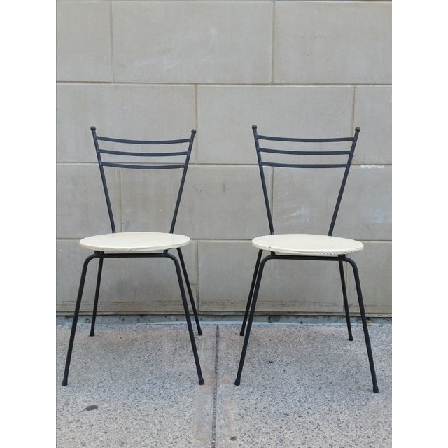 Mid century petite wrought iron cafe chairs pair chairish for Wrought iron cafe chairs