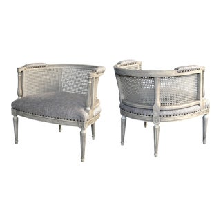 A stylish pair of Hollywood regency 1960's painted barrel-back chairs with caned back