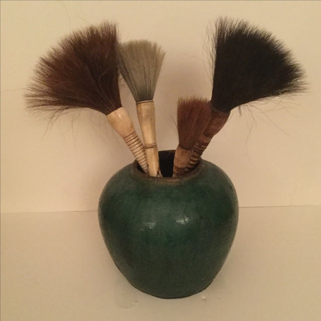 Image of Chinese Calligraphy Brushes in Pottery Vase