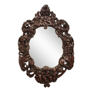 Large Oval Mirror with Carved Putti