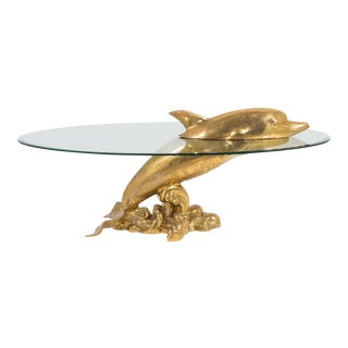 A Polished Brass and Glass Dolphin Coffee Table 1960s