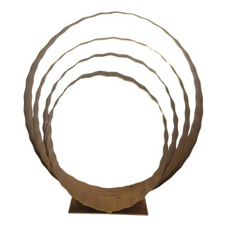 Gold Four Ring Metal Sculpture