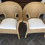 Image of Stackable Wicker Arm Chairs & White Cushions - A Pair