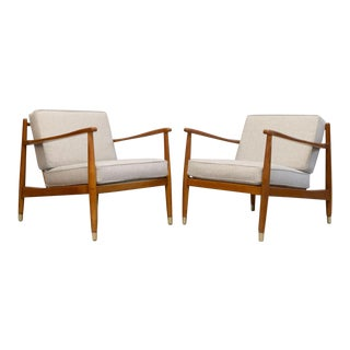 Folke Ohlsson for Dux Brass Capped Leg Lounge Chairs - A Pair