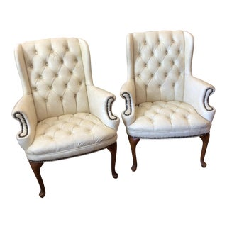 Tufted Leather Wing Chairs - A Pair