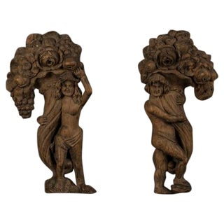 Pair of facing figures holding aloft cornucopia carved of oak from France c.1780
