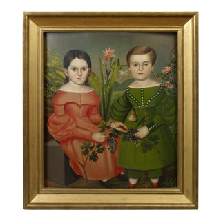Double Portrait of Two Children Wearing Red and Green Dresses Holding Grapes
