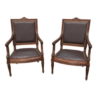 Hand Carved Lounge Chairs - A Pair