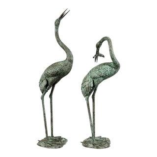 Bronze Cranes with Fish