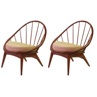 A stylish and mod pair of Danish modern 1950's walnut hoop chairs by Ib Kofod-Larsen