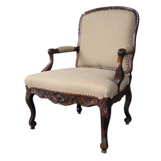 A Curvaceous Danish Rococo Style Carved Walnut Open Armchair