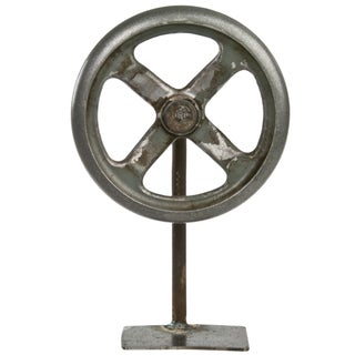 Vintage Rustic Industrial Wheel on Iron Stand