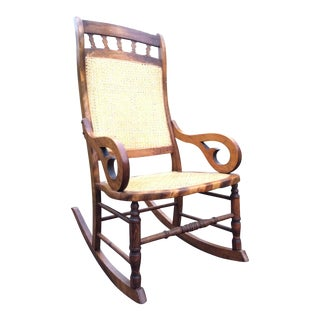 Hand Carved Oak and Cane Rocking Chair