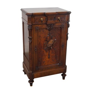 American Carved Walnut Cabinet
