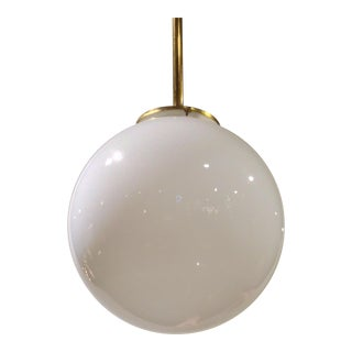 1940's milk glass globe pendant with brass rod.