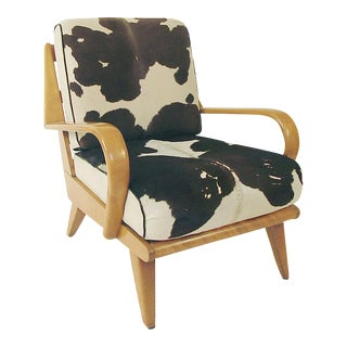 A Large Heywood Wakefield Armchair with Cowhide Cushions