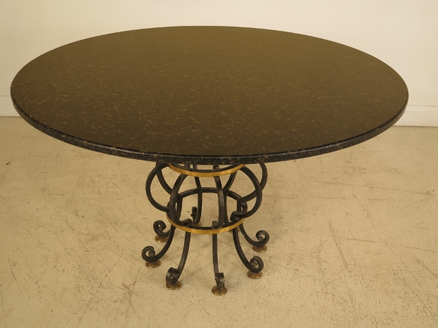 Round Granite Dining Table with Iron Base Chairish : 95f86fe9 f86f 461c b5a6 8f7dff2769ecaspectfitampwidth640ampheight640 from www.chairish.com size 640 x 640 jpeg 37kB