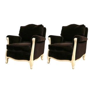 A Pair of French Chocolate Mohair - Creme Colored Distressed Painted Frame & Down Cushioned Fauteuil