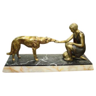 French Art Deco Patinated Metal Sculpture of a Deco Lady and Her Dog, C1940's