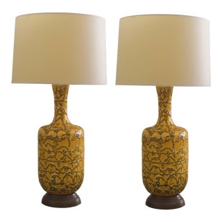 A mod pair of American 1960's mustard crater-glazed bottle-form lamps