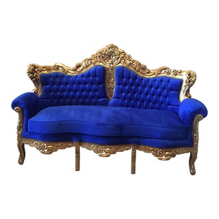 Blue Tufted Sofa and Gilded Frame Acanthus Details