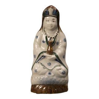 Devotional porcelain polychrome figure of a robed woman from Kuang Hsu period China c.1875