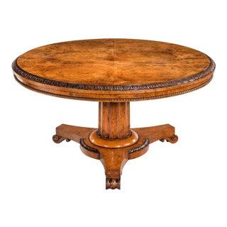 A Regency period pollard oak veneered centre table.