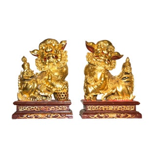Vintage Chinese Wood Carved and Gilt Foo Dogs - a Pair