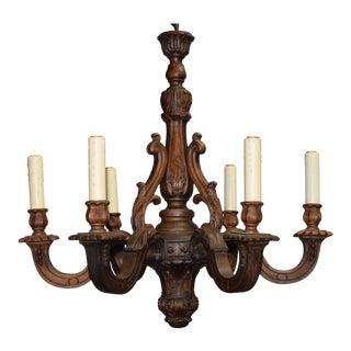 Antique chandelier, carved wood